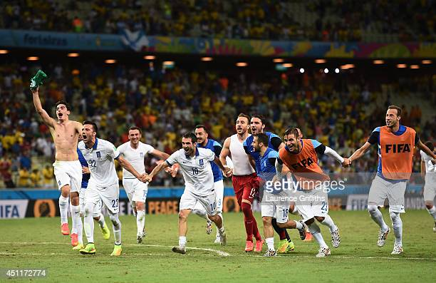 Greece celebrate after defeating the Ivory Coast 21 during the 2014 FIFA World Cup Brazil Group C match between Greece and the Ivory Coast at...