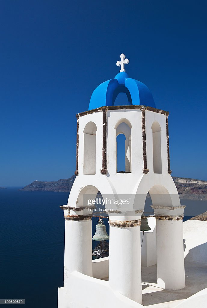 Greece, Cyclades Islands, Santorini, Oia, Church bell tower at coast