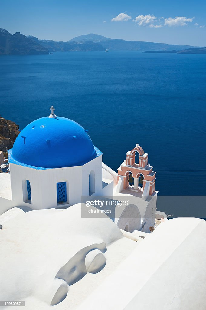 Greece, Cyclades Islands, Santorini, Oia, Church with bell tower at coast : Stock Photo