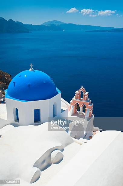 Greece, Cyclades Islands, Santorini, Oia, Church with bell tower at coast