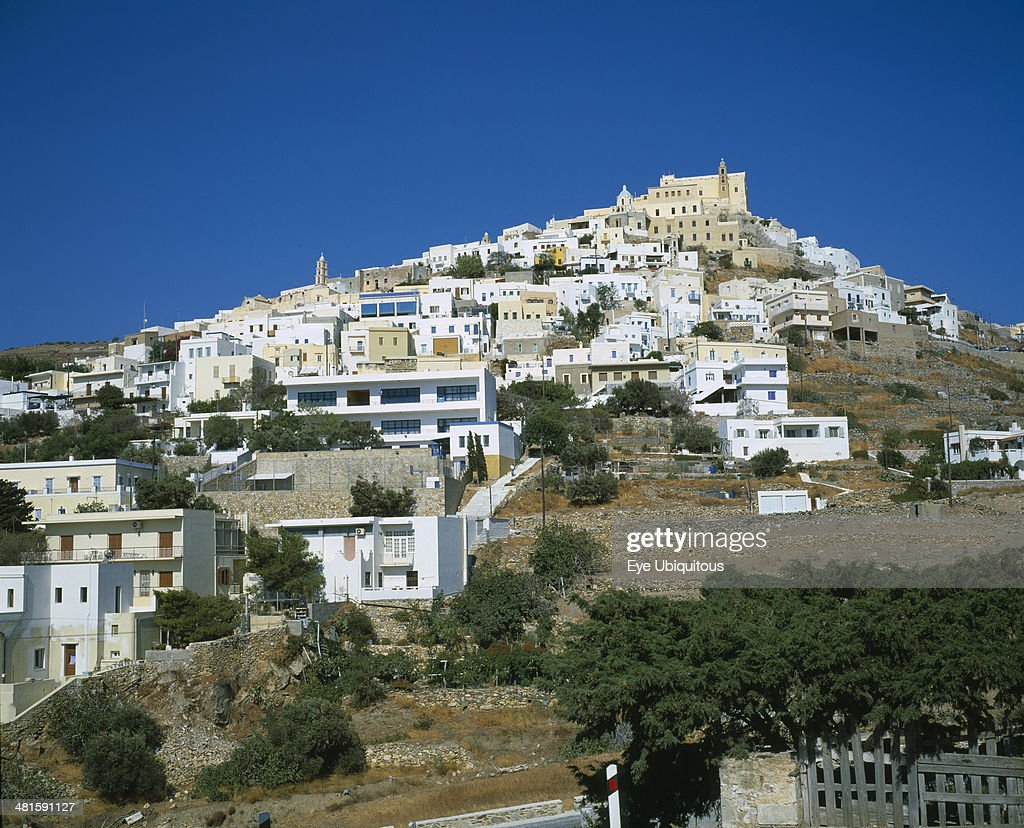 Greece Cyclades Islands Syros Ermoupolis The Catholic quarter of Ano Syros and church of Ag Yiorgios Houses covering mountain side with trees and a...