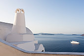 Greece, Cyclades, Thira, Santorini, Oia, View of chimney with caldera