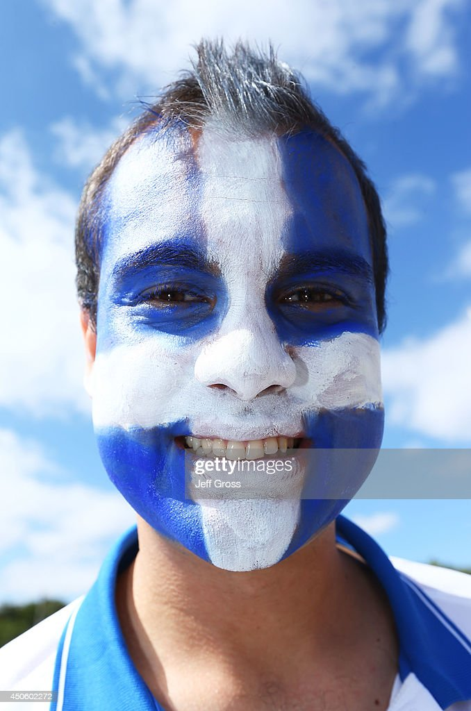 A Greece fan with a painted face enjoys the atmosphere prior to the 2014 FIFA World Cup Brazil Group C match between Colombia and Greece at Estadio Mineirao on June 14, 2014 in Belo Horizonte, Brazil.