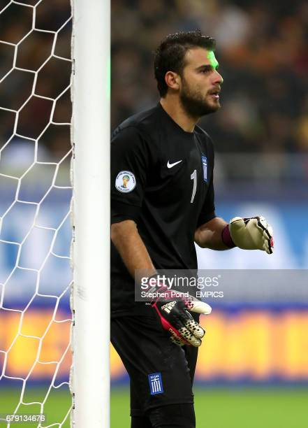 Greece goalkeeper Orestis Karnezis is targeted with a laser during the match
