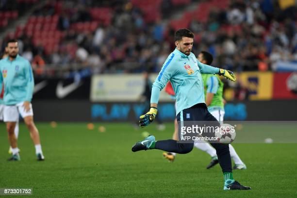 Greece goalkeeper Orestis Karnezis warms up ahead of the World Cup 2018 playoff football match Greece vs Croatia on November 12 2017 in Piraeus / AFP...