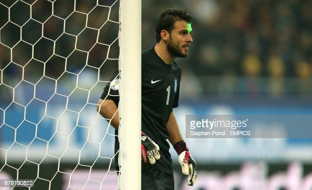 Greece goalkeeper Orestis Spiridon Karnezis is targeted with a laser during the match