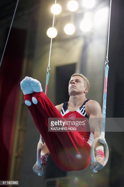 Guard Young of the US performs on the rings 16 August 2004 at the Olympic Indoor Hall during the men's team final in Artistic Gymnastics of the 2004...