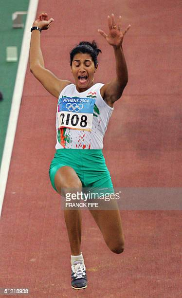 India's Anju Bobby George competes in the women's long jump qualifiers 25 August 2004 during the Olympic Games athletics competitions at the Olympic...