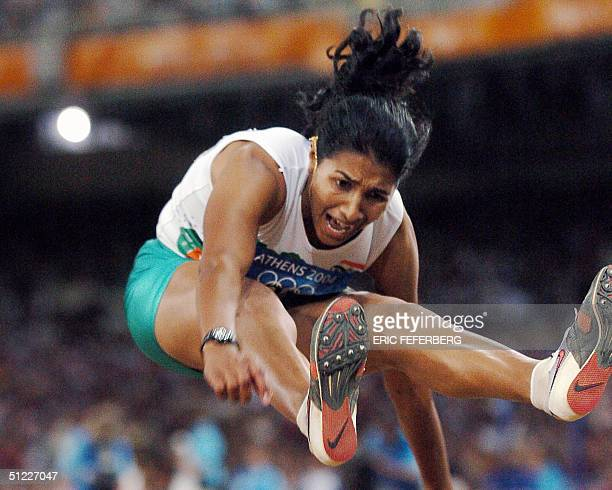 India's Anju Bobby George competes in the women's long jump final at the Olympic Stadium 27 August 2004 during the Olympic Games athletics...