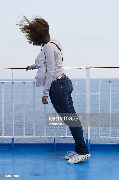 Greece, Ionian Islands, Ithaca, Mid adult woman standing on deck of boat
