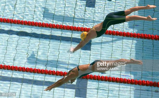 Leisel Jones from Australia and US Tara Kirk compete during the women's 100m breaststroke heat 6 at the 2004 Olympic Games at the Olympic Aquatic...
