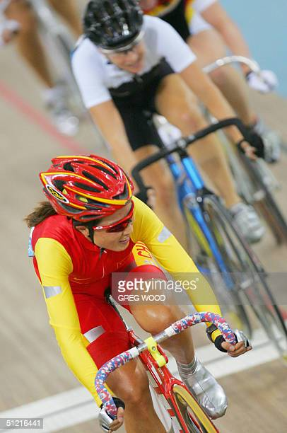 Li Meifang of China leads Sarah Ulmer of the New Zealand during their women's point race final in the Olympic Velodrome at the Olympic Games in...