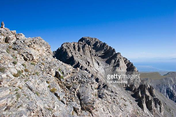 Greece Macedonia Pieria View of highest peak of Mount Olympus called Mytikas Eroded rocks and scree against blue cloudless sky
