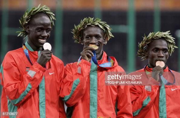 Men's 3000m steeplechase gold winner Ezekial Kemboi of Kenya and compatriots bronze winner Paul Kipsiele Koech and silver winnner Brimin Kipruto pose...