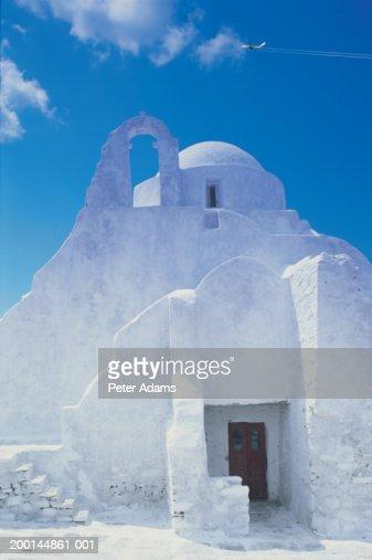 Greece, Mykonos Island, Mykonos Town, plane flying over church