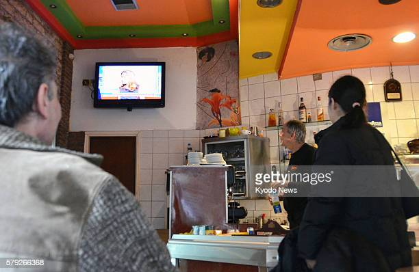 ATHENS Greece People watch a TV news program at a cafe in central Athens on Nov 10 2011 The president's office said the same day that former Vice...