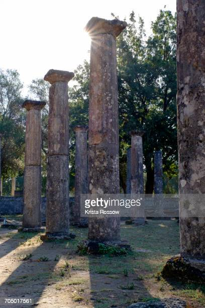 Ancient columns at ruins of Olympia on Greeces Peloponnese peninsula.