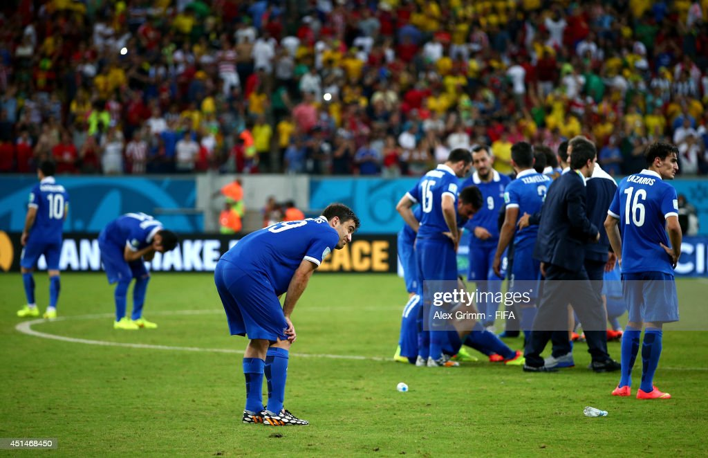 Greece players show their dejection after the defeat in the 2014 FIFA World Cup Brazil Round of 16 match between Costa Rica and Greece at Arena Pernambuco on June 29, 2014 in Recife, Brazil.