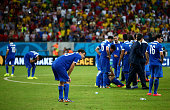 Greece players show their dejection after the defeat in the 2014 FIFA World Cup Brazil Round of 16 match between Costa Rica and Greece at Arena...