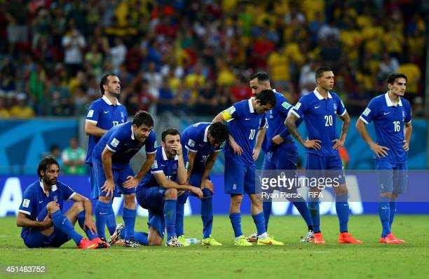 Greece players watch a penalty shootout during the 2014 FIFA World Cup Brazil Round of 16 match between Costa Rica and Greece at Arena Pernambuco on...