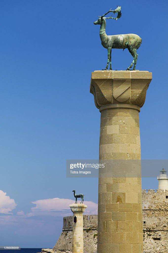 Greece, Rhodes, Mandraki Harbor, Statues on columns
