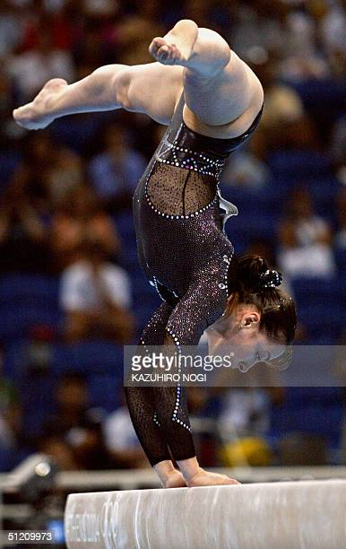 Romania's gold medallist Catalina Ponor performs during the women's beam final 23 August 2004 at the Olympic Indoor Hall in Athens during the...