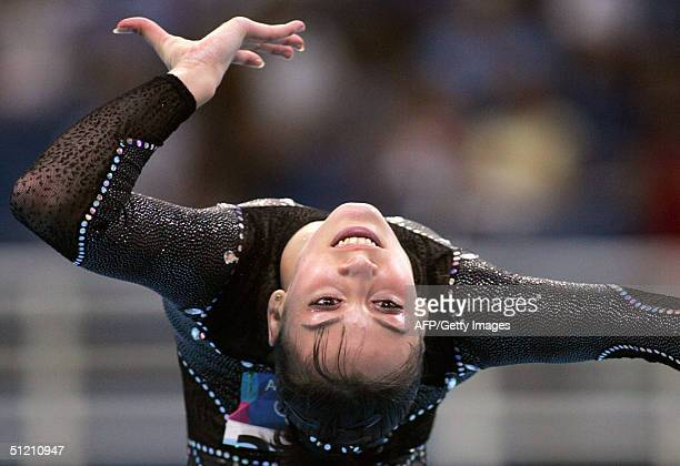 Romania's gold medallist Catalina Ponor performs during the women's floor exercice final 23 August 2004 at the Olympic Indoor Hall in Athens during...