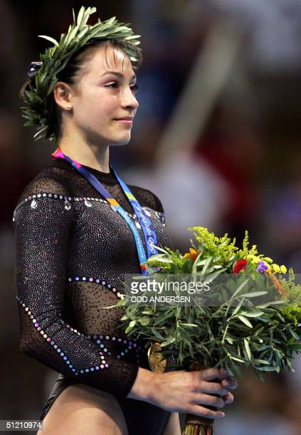 Romania's gold medallist Catalina Ponor smiles on the podium of the women's floor exercice 23 August 2004 at the Olympic Indoor Hall in Athens during...