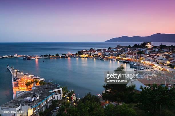 Greece, Samos, Pythagorio, harbour illuminated at dusk