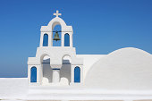 Greece, Santorini, Whitewashed traditionally Greek bell tower and cross in Oia