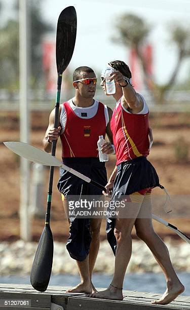 Spanish Javier Hernanz and Pablo Banos chat after finishing fourth place in the Men's K2 1000m heats for the Athens 2004 Olympic Games at the...