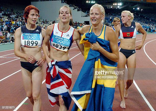 Sweden's Carolina Kluft celebrates with Britain's Kelly Sotherton and Germany Sonja Kesselschlaeger after the women's heptathlon competitions at the...