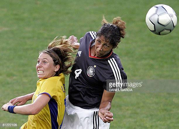 Swedish defender Sara Larsson and German defender Steffi Jones jump to intercept the ball during the bronze medal football match between Germany and...