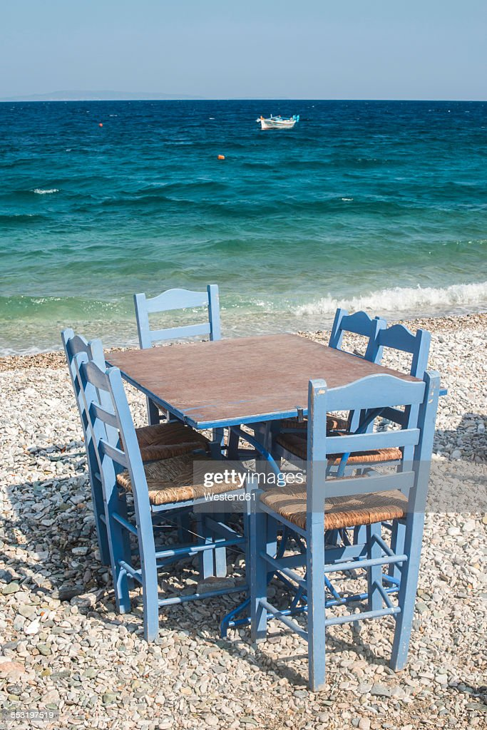 Greece, Table And Chairs Of Taverna At Seashore : Stock Photo