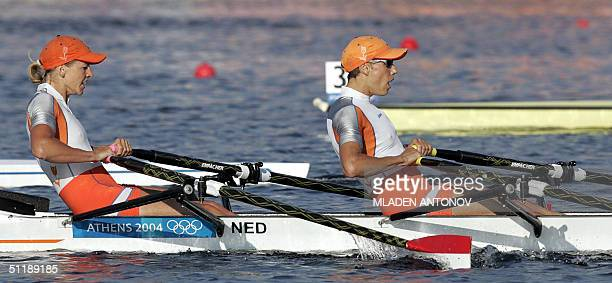 utch Kirsten van Der Kolk and Marit va Eupen power to finish in second place during the Lightweight Women's Double Sculls semifinal in the Athens...
