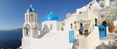 Greece, View of classical whitewashed church and bell tower at Oia