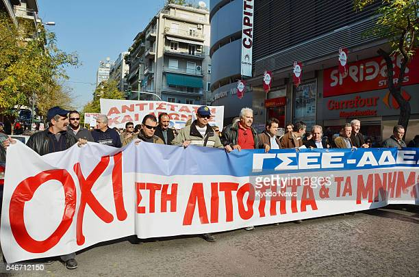 ATHENS Greece Workers march through the streets in Athens on Dec 1 as labor unions carried out a 24hour strike throughout Greece the same day It was...
