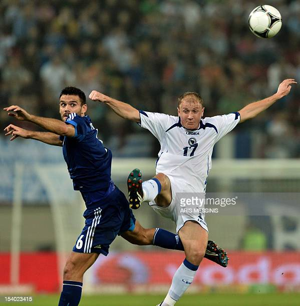 Greece's Alexandros Tziolis fights for the ball with BosniaHerzegovina's Senijad Ibricic during their 2014 World Cup qualifier football match in...