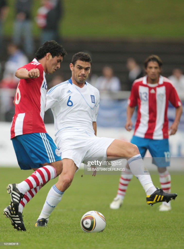 Greece's Alexandros Tziolis (R) vies for the ball with Paraguay's Cristian Riveros during a friendly football game in Winterthur on June 2, 2010 ahead of their participation to the FIFA World Cup 2010 in South Africa.