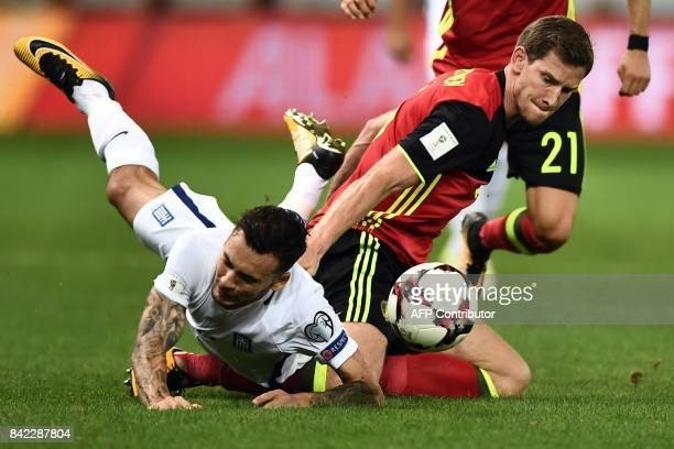 Greece's Anastasios Donis fights for the ball with Belgium's Jan Vertonghen during the 2018 FIFA World Cup qualifying football match between Greece...