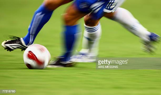 Greece's and Bosnia's players run for the ball during their Euro 2008 qualifying soocer match at the Olympic stadium in Athens 13 October 2007 AFP...