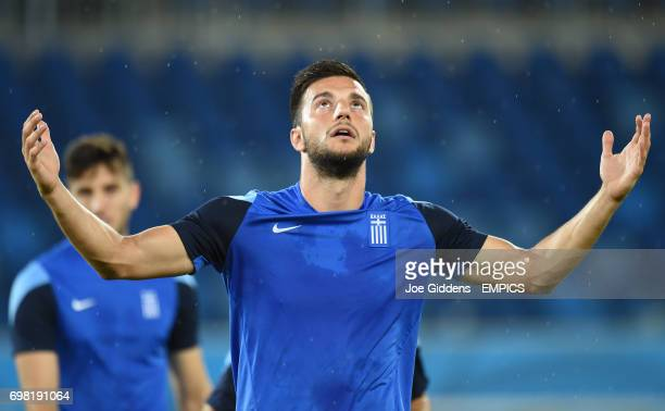 Greece's Andreas Samaris reacts as rain begins to fall during a training session at Arena das Dunas in Natal
