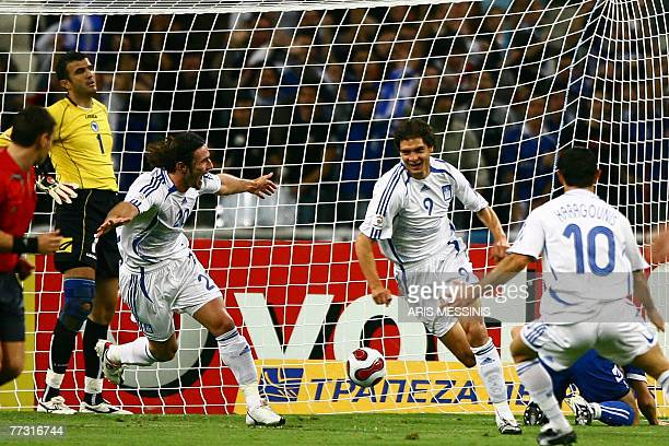 Greece's Angelos Charisteas celebrates after scoring against Bosnia during their UEFA Euro 2008 qualifying football game in Athens 13 October 2007...