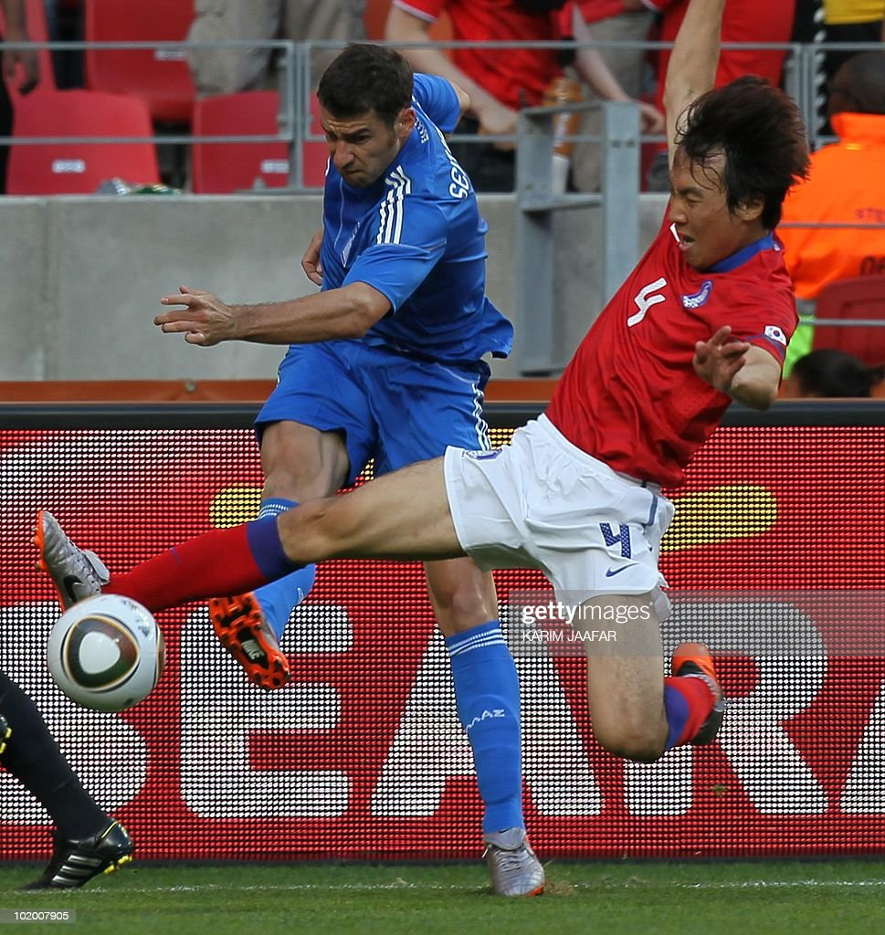 Greece's defender Giorgos Seitaridis fights for the ball with South Korea's defender Cho YongHyung during the Group B first round 2010 World Cup...