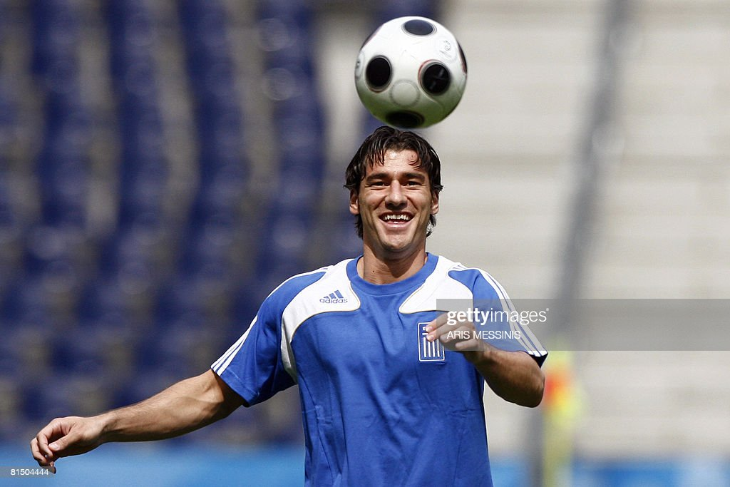 Greece's defender Giourkas Seitaridis plays with the ball during a team training session in Salzburg on June 9 one day before their Group D game...