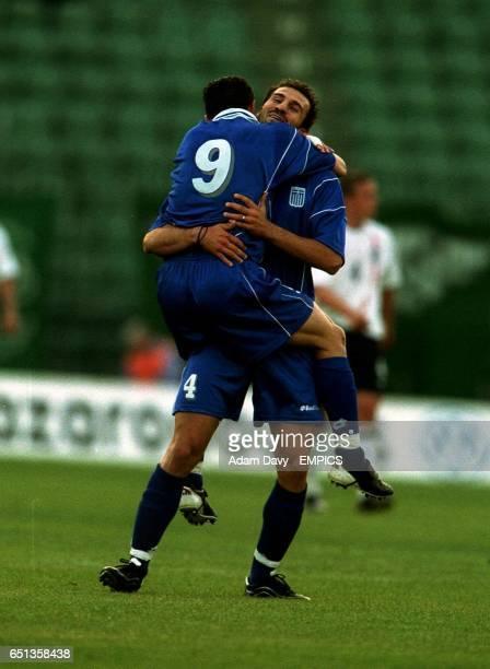 Greeces' Dimitrios Papadopoulos celebrates his goal with Georgios Kyriazis