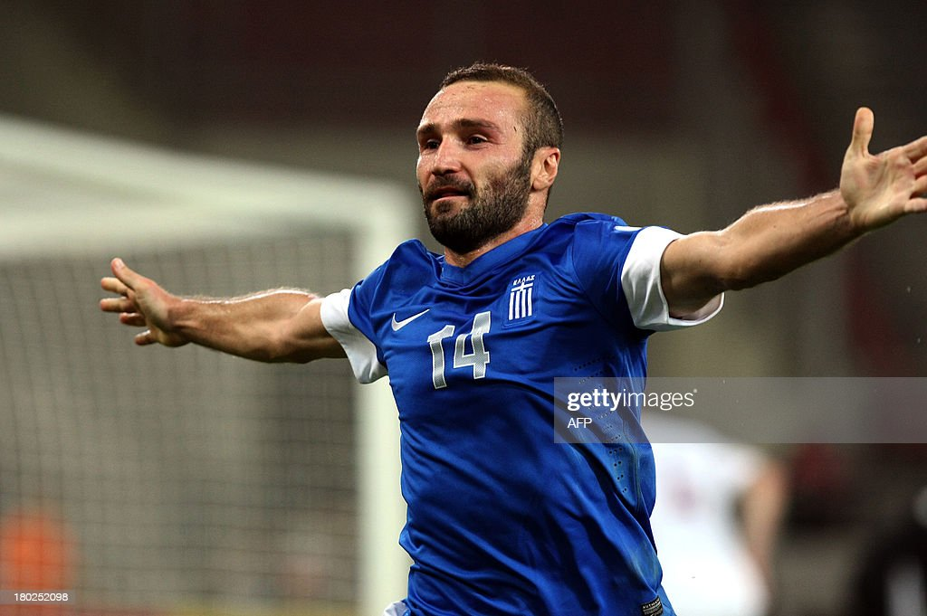 Greece's Dimitris Salpingidis celebrates after scoring against Latvia during their 2014 World Cup qualification game in Athens on September 10, 2013. AFP PHOTO / Dimitris Birdachas