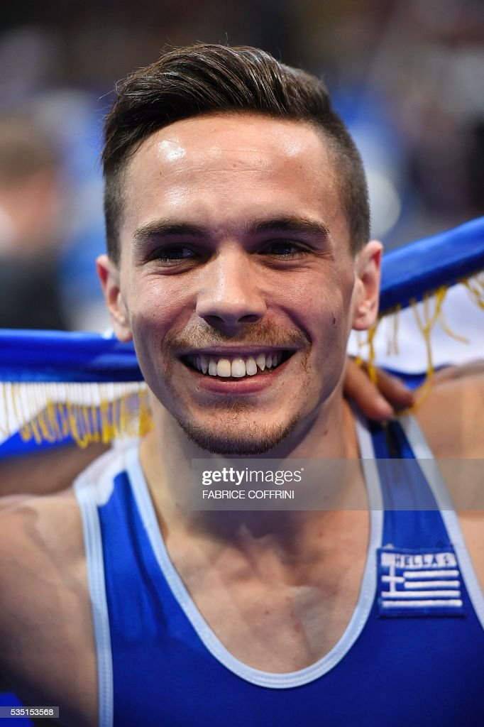Greeces Eleftherios Petrounias celebrates winning after the Mens Rings competition of the European Artistic Gymnastics Championships 2016 in Bern, Switzerland on May 29, 2016. / AFP / FABRICE