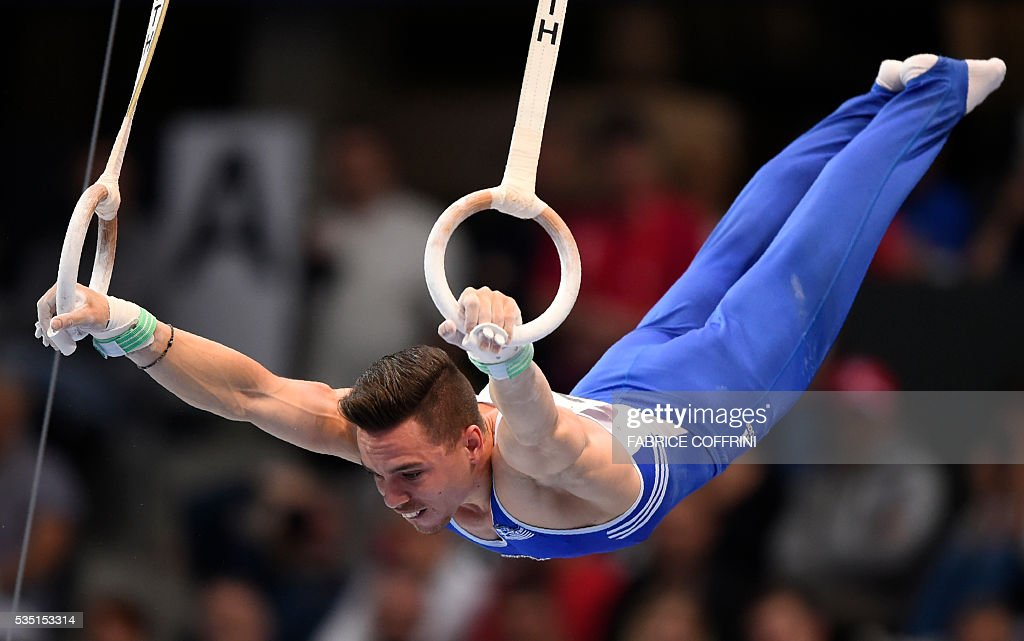 Greeces Eleftherios Petrounias performs during the Mens Rings competition of the European Artistic Gymnastics Championships 2016 in Bern, Switzerland on May 29, 2016. / AFP / FABRICE