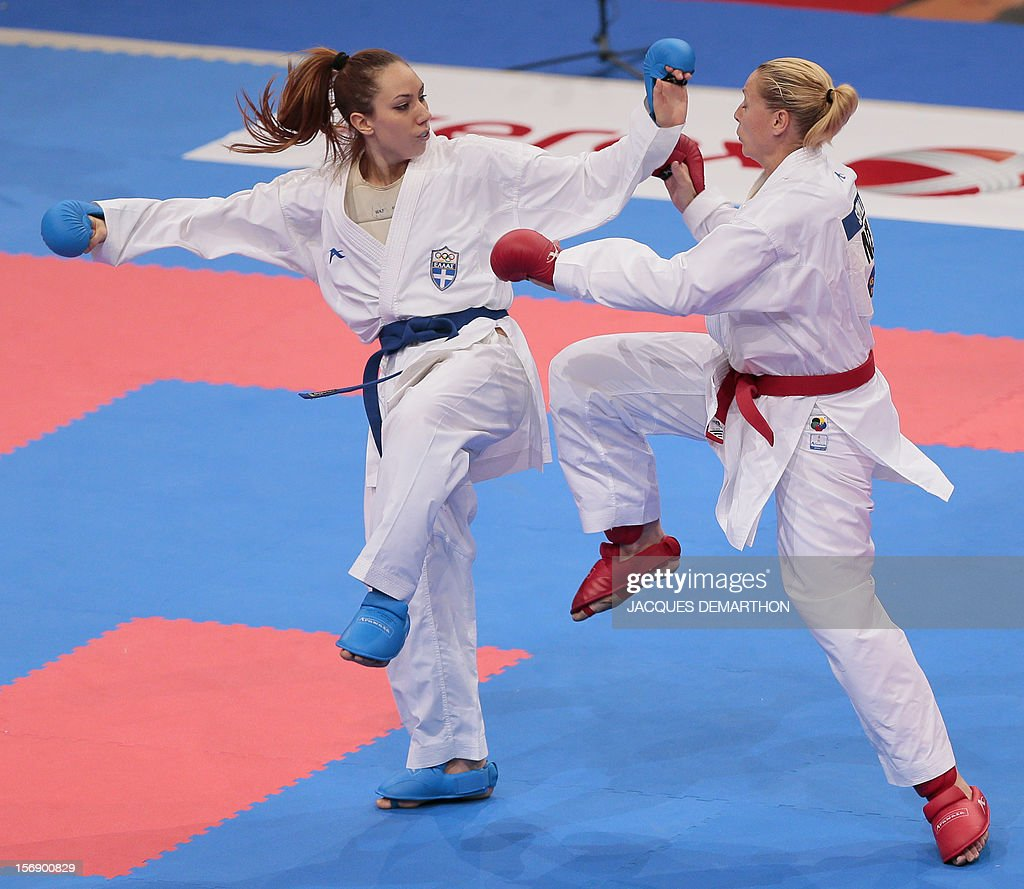 Greece's Eleni Hatziliadou (L) fights against New Zealand's Sophie Savill (R) during their women's bronze medal bout in the over 68 kg category at the Karate world championships on November 24, 2012 in Paris. Hatziliadou won the bout.